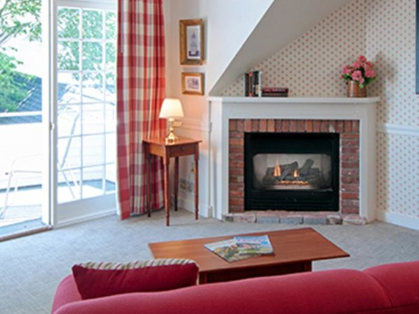 The Inn at Mill Falls, Bell Tower Suite, Living Area with Fireplace and Balcony